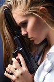 Girl with gun — Stock Photo