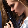 Girl with pistol - Stock Photo