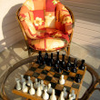 Chess game and garden chair — Stock Photo