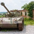 Stock Photo: Tank in front of broken house