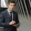 Stock Photo: Business man on his ipad