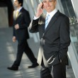 Senior business man smiling on the phone — 图库照片