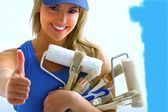 Girl and painting tools — Stock Photo