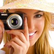 Blond girl portrait with camera — Stockfoto