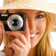 Blond girl portrait with camera — Stock Photo #11740106