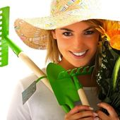 Girl portrait with gardening tools — Stock Photo