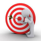 Person satisfied is showing an arrow at the center of target — Stock Photo