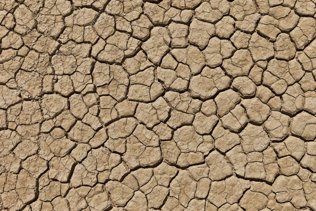 Seco agrietado suelo del desierto — Foto de stock © jamenp ...