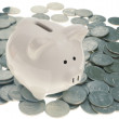 Piggy Bank On Pile Of Quarters Coins, Lit From Below To Eliminate Shadows - Semi Reflective White Pig - Stock Photo