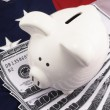 Piggy Bank Over American Flag And 100 Dollar Bills — Stock Photo #12071376