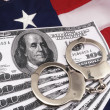100 Dollar Bills And Hand Cuffs Over American Flag — Stock Photo