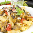 Sicilirigatoni with eggplant, tomato and parmesan — Stock Photo #11659932