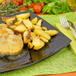 Stock Photo: Pork loin in sauce with potatoes