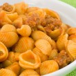 Shells in tomato sauce with sausage — Stock Photo