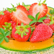 Melon with strawberries — Stock Photo