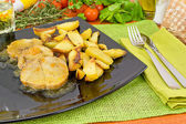 Pork loin in sauce with potatoes — Stock Photo