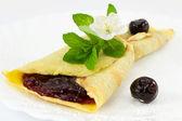 Crepes with black cherry jam — Stock Photo