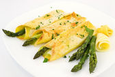 Crepes with asparagus and cream sauce — Stock Photo
