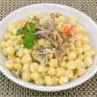 Gnocchi with porcini mushrooms - Stock Photo