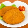 Breaded fish fillet - Stock Photo