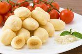 Gnocchi- Dumplings stuffed with mozzarella and tomato sauce — Stock Photo