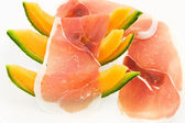 Ham and melon — Stock Photo