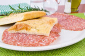 Stuffed pizza with salami — Stock Photo