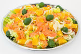 Smoked salmon with salad and pieces of orange — Stock Photo