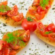 Bruschettwith tomato — Stock Photo #11993249