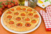 Focaccia with tomatoes and oregano — Stock Photo
