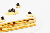 Mille-feuille with cream and black cherry — Stock Photo