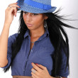 Woman with black hair and blue hat - Stock Photo