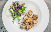 Tofu with spices and olive oil — Stock Photo