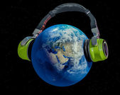 Earth listening music — Stock Photo