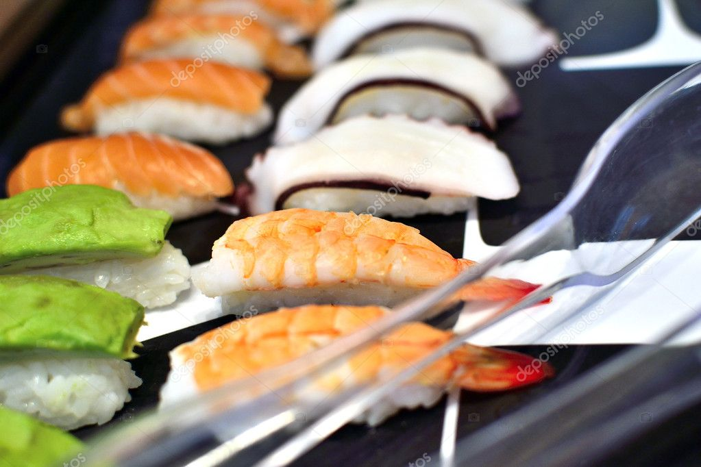Sushi rolls on a black plate.  Stock Photo #11660628