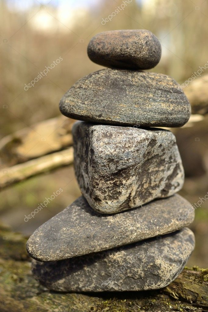 Pile of stones near a river — Stock Photo #11661104