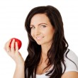 Beautiful young lady with delicious red apple — Stock Photo