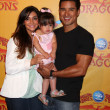 Royalty-Free Stock Photo: Courtney Mazza, Mario Lopez and their daughter