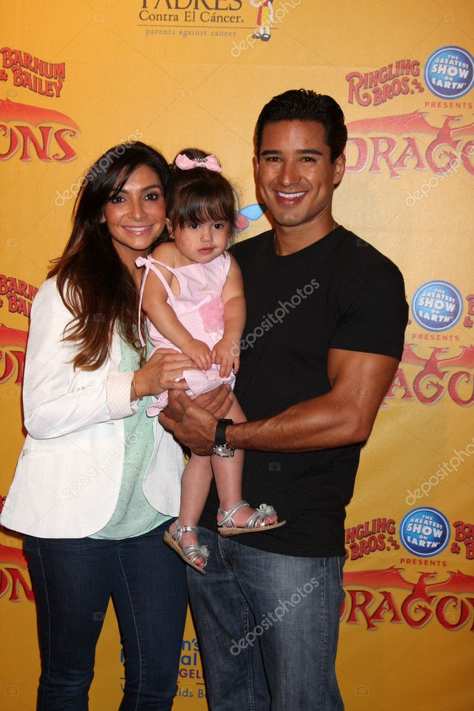 LOS ANGELES - JUL 12:  Courtney Mazza, Mario Lopez and their daughter arrives at 'Dragons' presented by Ringling Bros. & Barnum & Bailey Circus at Staples Center on July 12, 2012 in Los Angeles, CA  Stock Photo #11660240