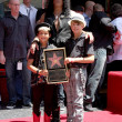 Foto Stock: Slash and two sons