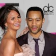 Постер, плакат: Christine Teigen and John Legend