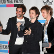 Muse - Christopher Wolstenholme, Matthew Bellamy and Dominic Howard - Stock Photo