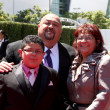 Rico Rodriguez and parents - Stock Photo