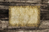 Old paper on wood — Stock Photo