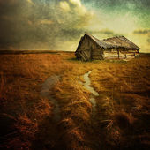 Old haunted house on the empty field — Stock Photo