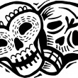 A black and white drawing of two skulls with happy and sad expressions — Stock Photo