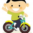 A young boy riding a bicycle — Stock Photo