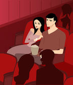 A couple at the theatre watching a movie — Stock Photo