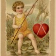 A vintage Valentines Day card with a cupid fishing a heart — Stock Photo #12092270