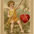A vintage Valentines Day card with a cupid fishing a heart — Stock Photo